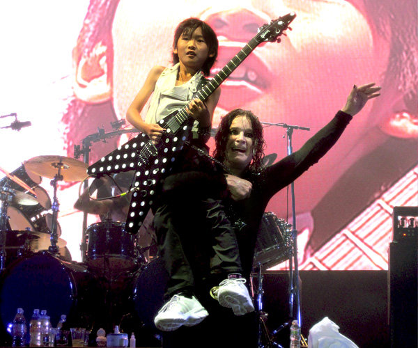 Ozzy Osbourne and Yuto Miyazawa at Ozzfest in Camden NJ August 22, 2010